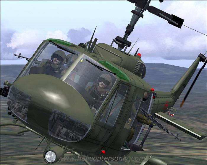 飞机的机身还在燃烧,不时有机炮炮弹从火里窜出,uh-1d上的人员马上跳